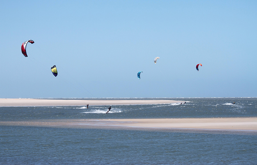 The kitesurf spot in Atins. Flat water and kites in the air.