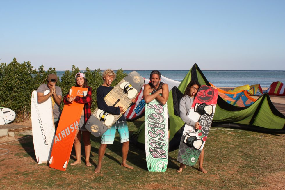 A group of kitesurfers posing in front of Kite Bubble kite spot