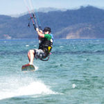 Ken doing a jump while kitesurfing in Bahia Salinas, Costa Rica.