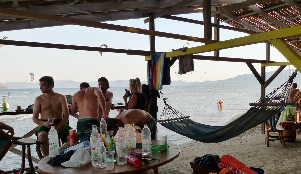 People at the kitesurf beach bar at Komin Kiteboarding, Croatia