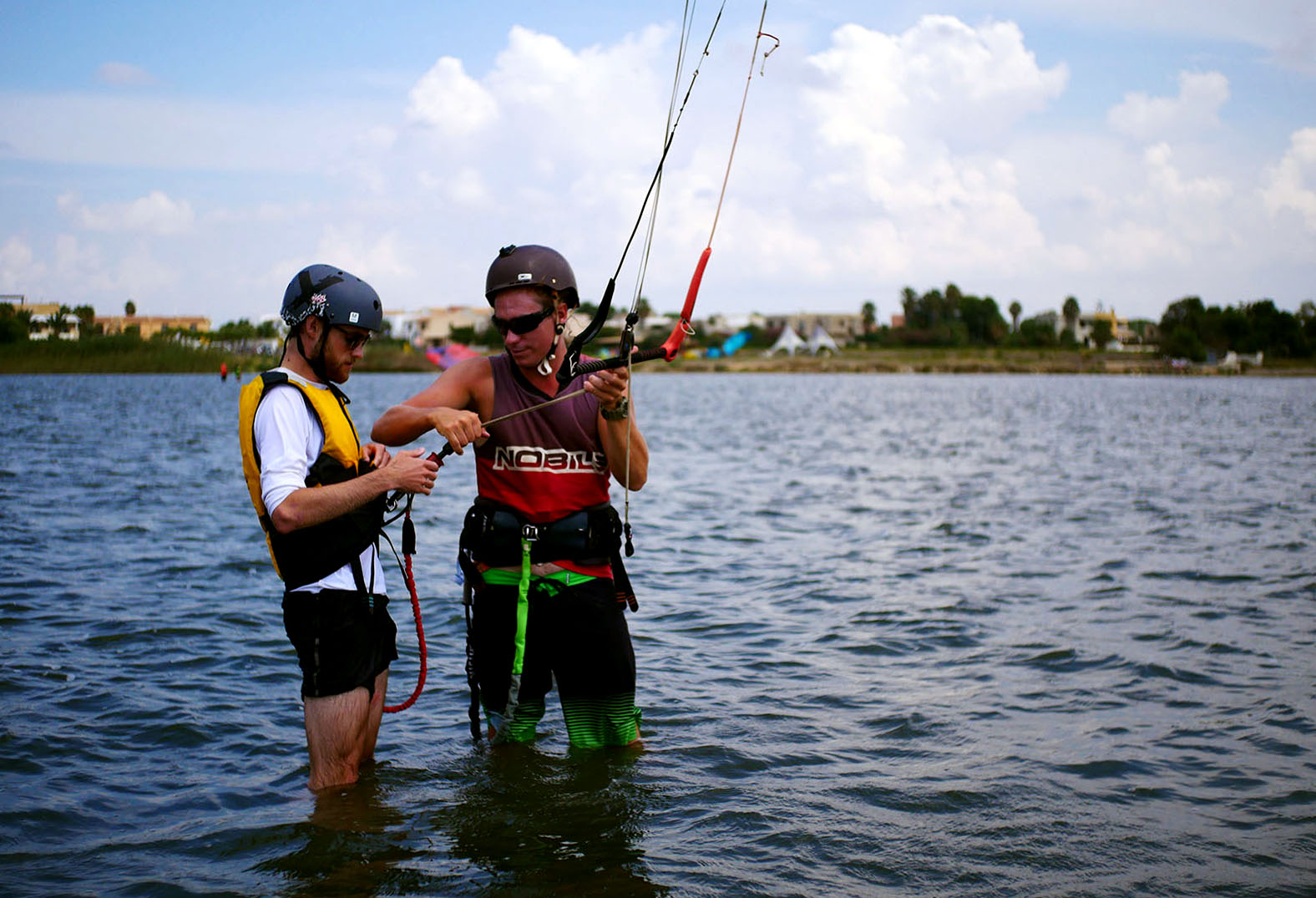 Kite teach and student in knee deep water, Lo Stagnone lagoon