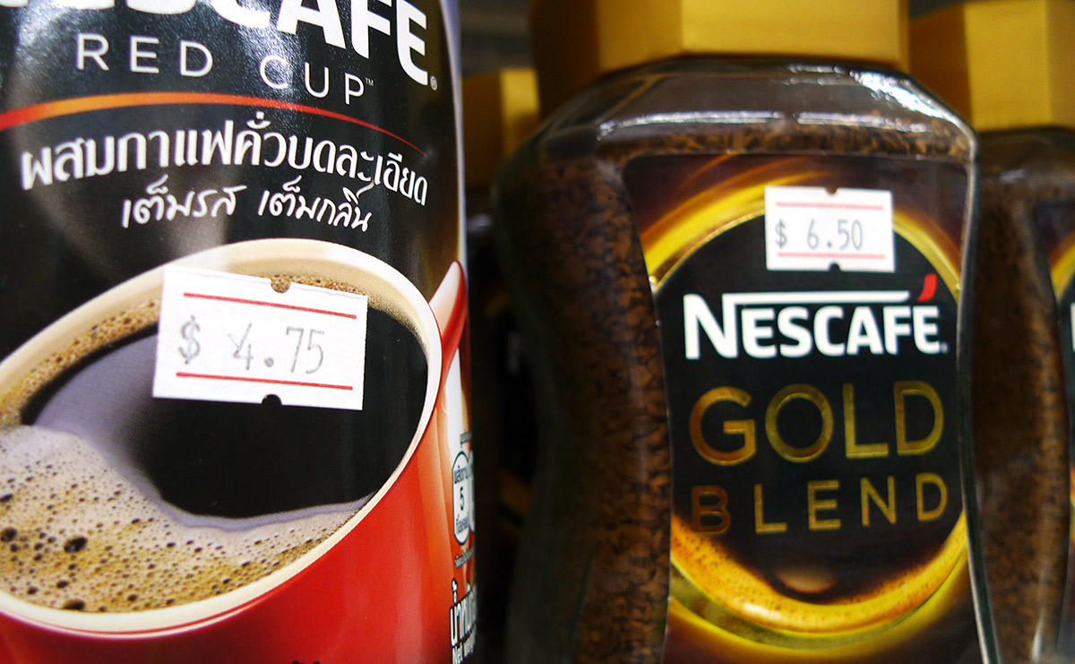 Price tags on instant coffee jars in super market