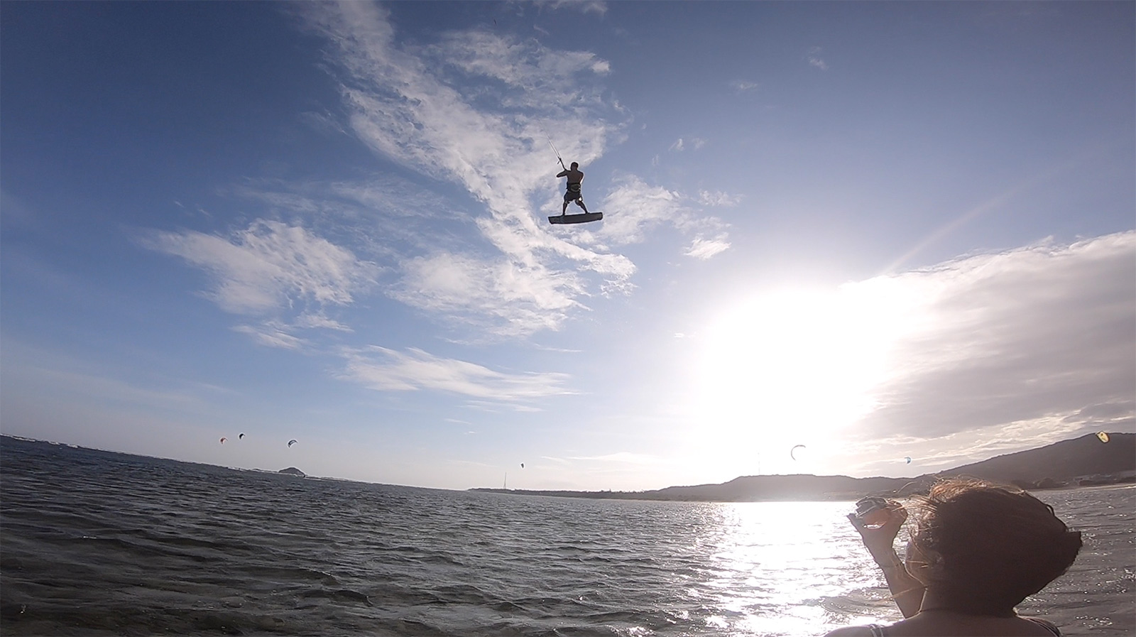 Kitesurf flying high while being filmed. My Hoa lagoon, Phan Rang