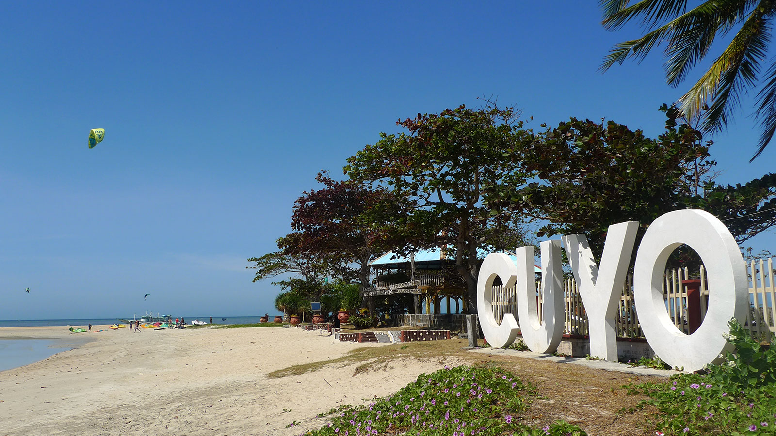 Cuyo sign and Capusan kitesurfing beach in the background.