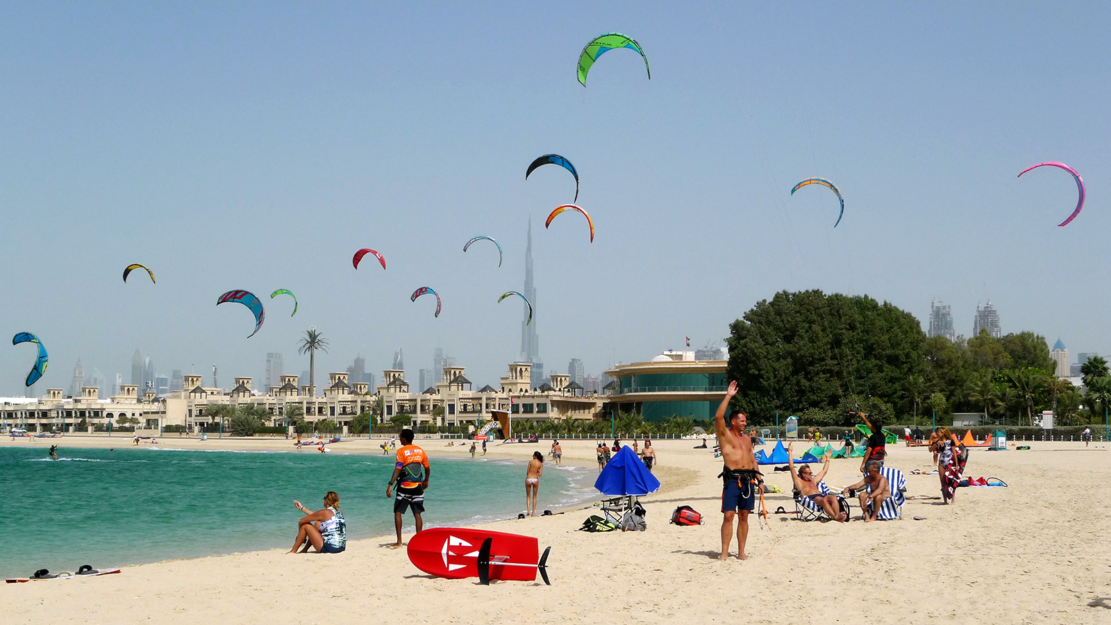 Kites flying at Nessnass beach in Dubai with Burj Khalifa in the background