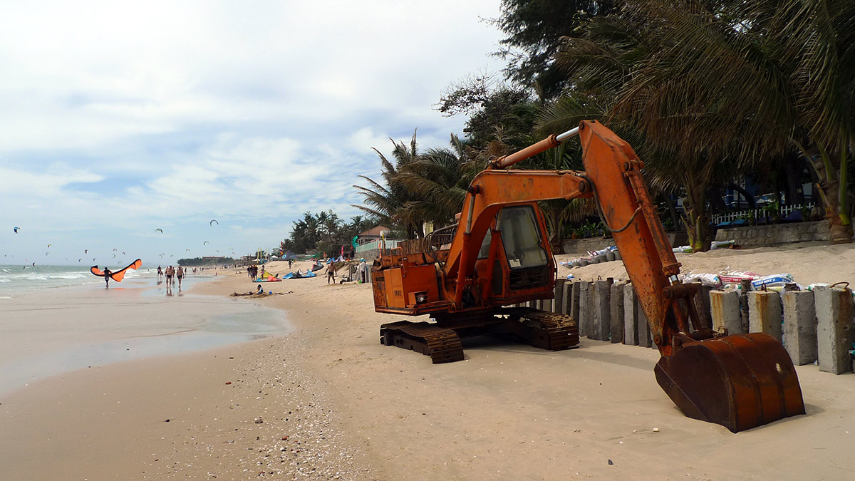 Excavator on the beach in Mui Ne