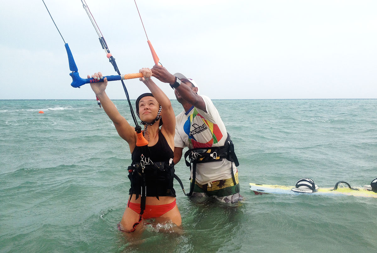 woman receiving instructions from a kitesurf instructor in Egypt.