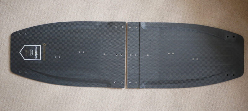 split kiteboard in two halves, showing the concept of a foldable board.
