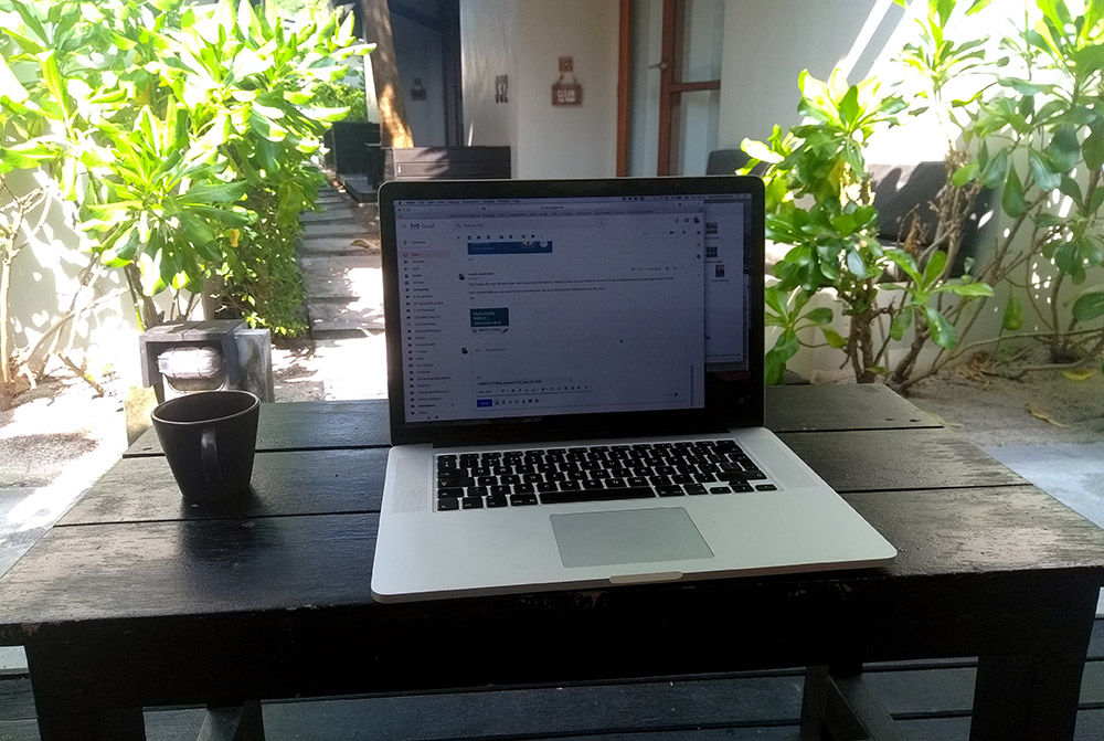 Laptop outside bungalow