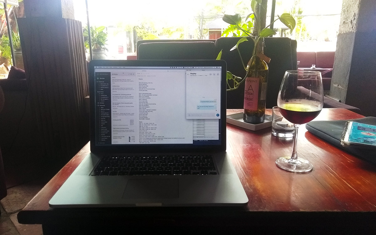 Laptop and a glass of wine in a cafe in Mui Ne
